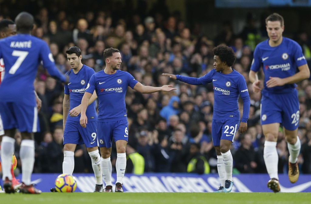 Chelsea's Daniel Drinkwater, centre left, taps hands with Willian after he scores his side's second goal during their English Premier League soccer ma...
