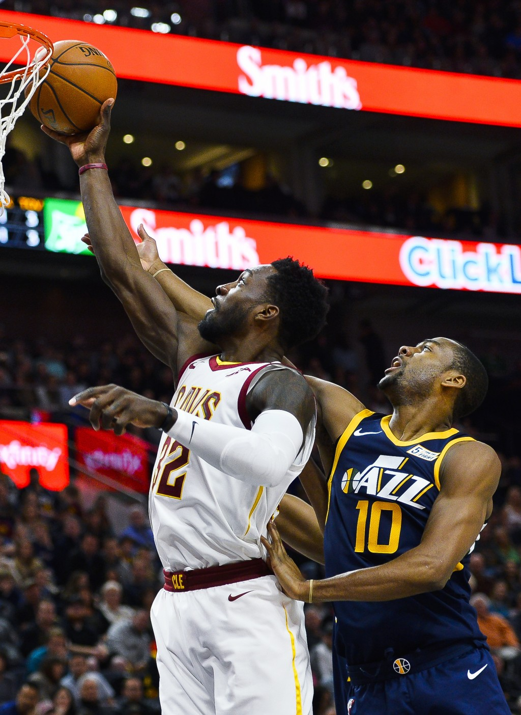 Cleveland Cavaliers forward Jeff Green (32) attempts a shot under Utah Jazz guard Alec Burks (10) in the first half of an NBA basketball game Saturday...