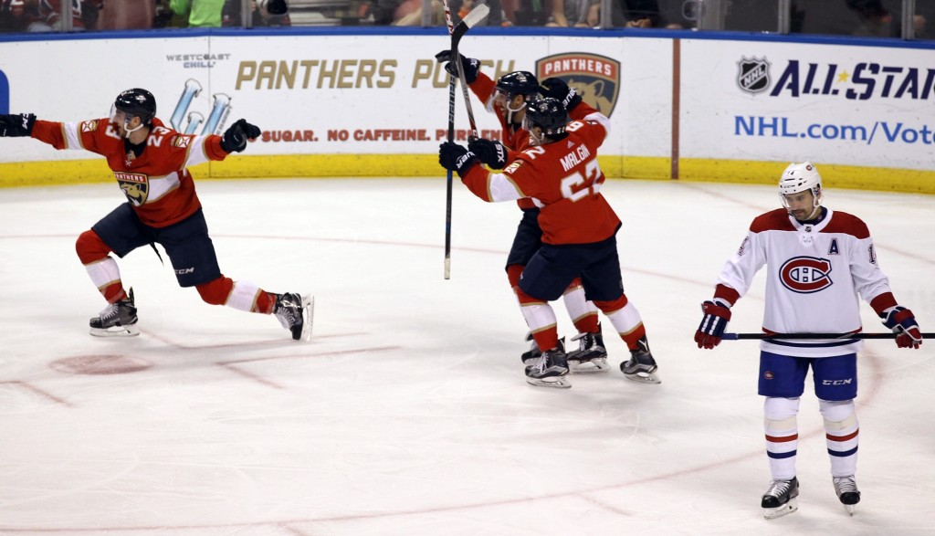 Florida Panthers' Connor Brickley, left, celebrates after scoring a goal against the Montreal Canadiens as teammates Denis Malgin, center right, of Sw...