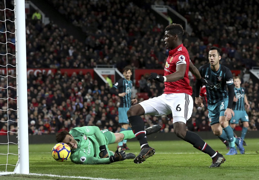Manchester United's Nemanja Matic shoots at the goal whilst Paul Pogba, centre, follows it in but was ruled off side during the English Premier League...