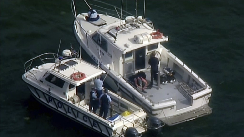 This image made from a video, shows search and rescue teams on back of boats in Hawkesbury River, New South Wales, Australia Sunday, Dec. 31, 2017. A ...