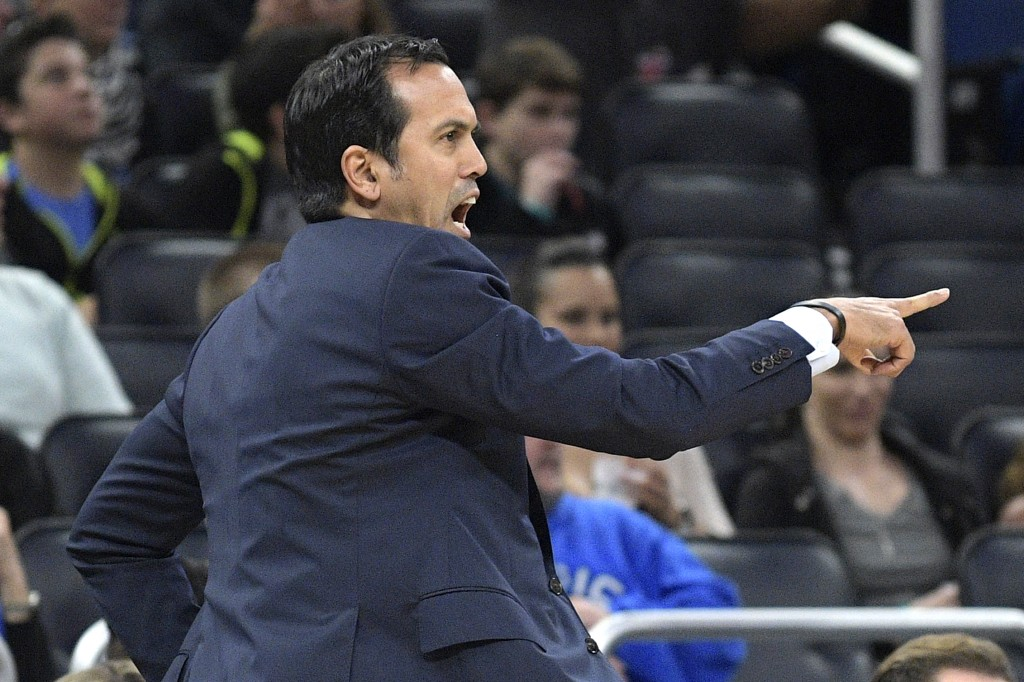 Miami Heat head coach Erik Spoelstra shouts instructions during the first half of an NBA basketball game against the Orlando Magic, Saturday, Dec. 30,...