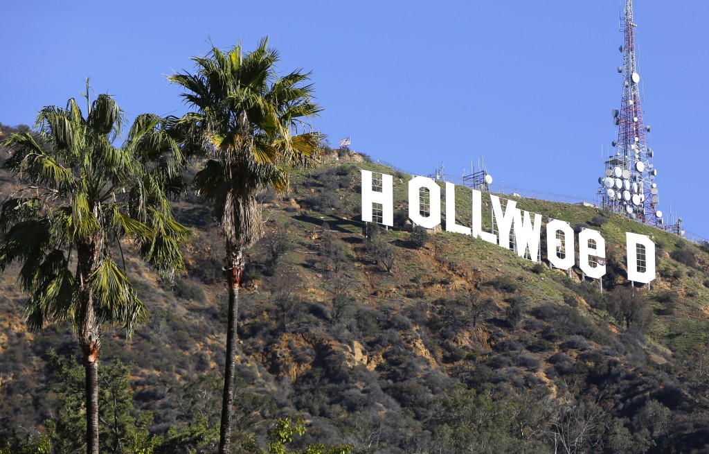 FILE - In this Jan. 1, 2017, file photo, the Hollywood sign is seen vandalized. Los Angeles residents awoke New Year's Day to find a prankster had alt...