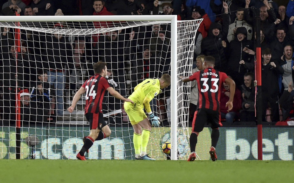 AFC Bournemouth's Ryan Fraser, left, celebrates scoring his side's second goal of the game against Everton during the English Premier League soccer ma...