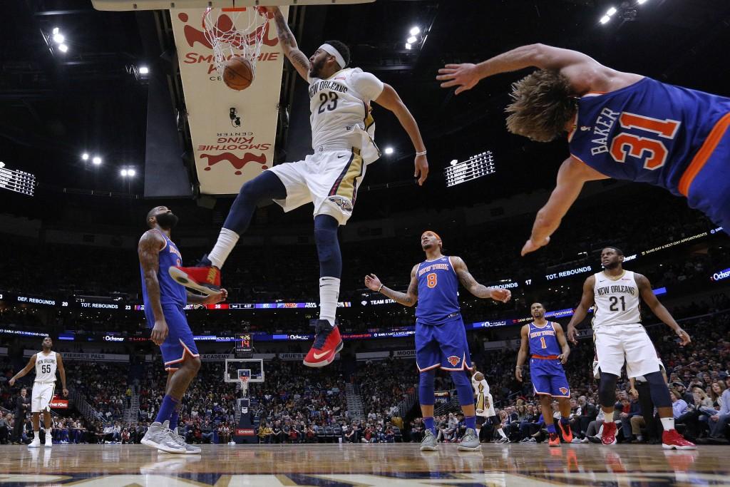New Orleans Pelicans forward Anthony Davis (23) dunks between New York Knicks forward Michael Beasley (8), center Kyle O'Quinn, left, and guard Ron Ba...