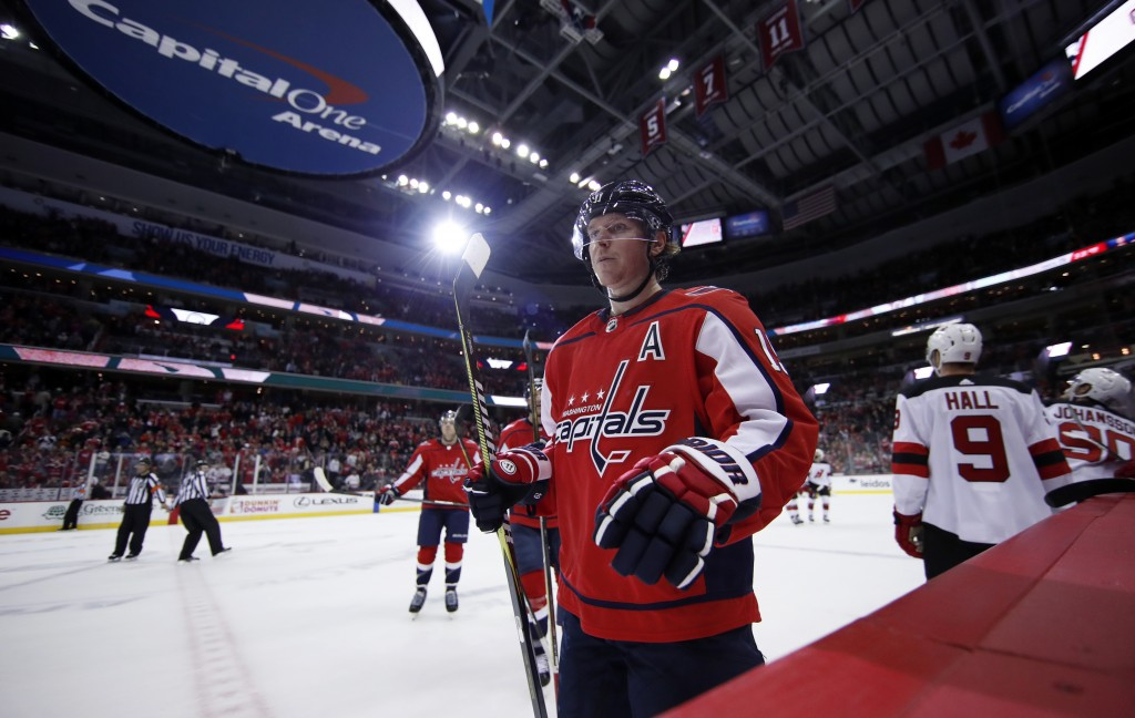 Washington Capitals center Nicklas Backstrom, from Sweden, comes to bench to celebrate his empty net goal in the third period of an NHL hockey game ag...