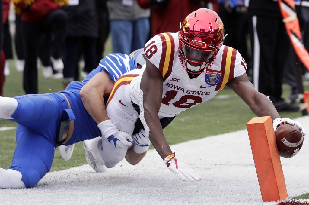 Iowa State wide receiver Hakeem Butler (18) reaches for the goal line but is knocked out of bounds at the 3-yard line by Memphis defensive back Austin...