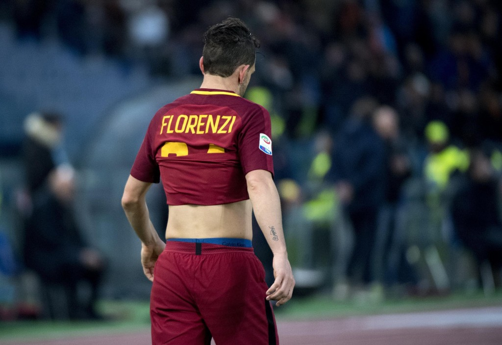 Roma's Alessandro Florenzi walks off the field at the end of the Serie A soccer match between Roma and Sassuolo at the Olympic stadium in Rome, Saturd...