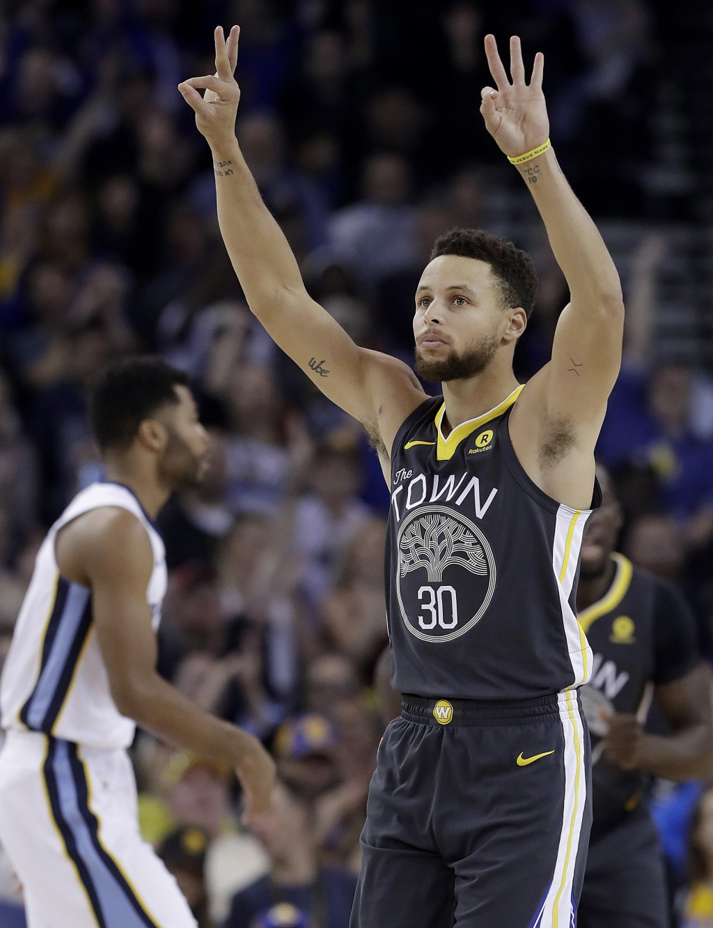Golden State Warriors guard Stephen Curry (30) gestures after scoring during the first half of the team's NBA basketball game against the Memphis Griz...