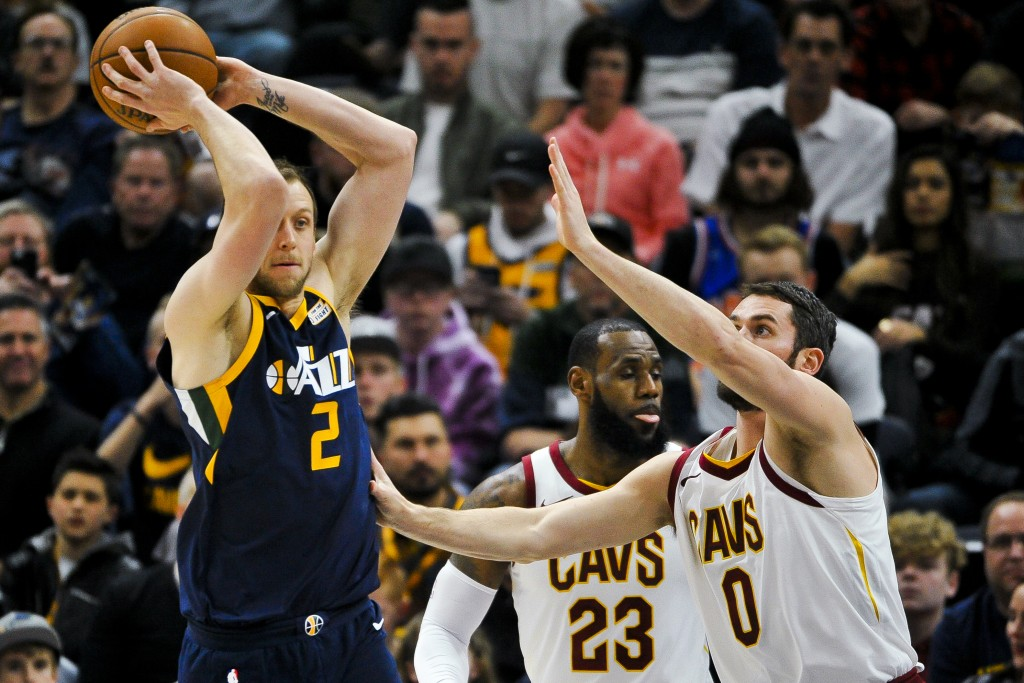 Utah Jazz forward Joe Ingles (2) looks to pass over Cleveland Cavaliers forward Kevin Love (0) in the first half of an NBA basketball game Saturday, D...