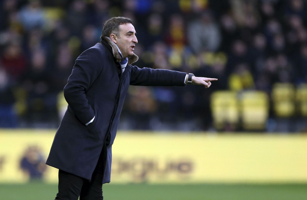Swansea City manager Carlos Carvalhal during the English Premier League soccer match against Watford at Vicarage Road, London, Saturday Dec. 30, 2017....