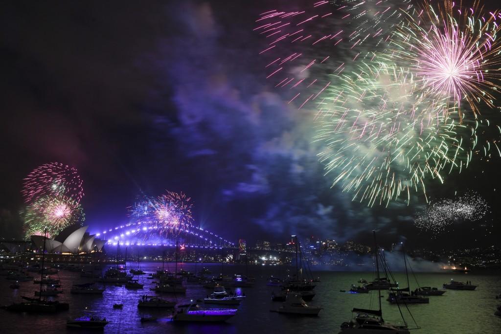 Fireworks explode over Sydney Harbour during New Year's Eve celebrations in Sydney, Sunday, Dec. 31, 2017. (David Moir/AAP Image via AP)