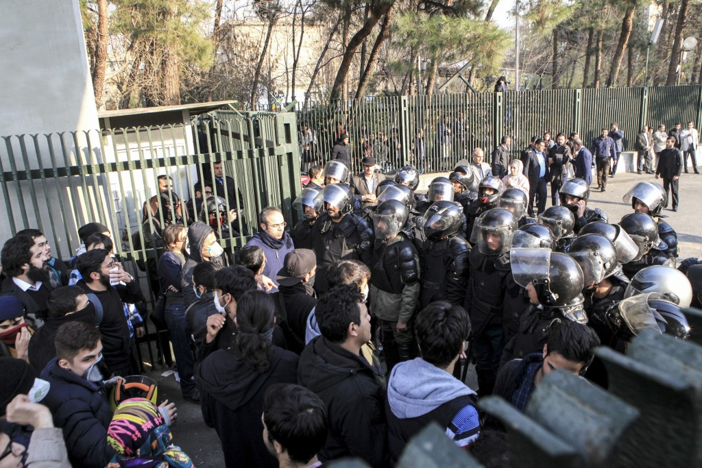 In this photo taken by an individual not employed by the Associated Press and obtained by the AP outside Iran, anti-riot Iranian police prevent univer...