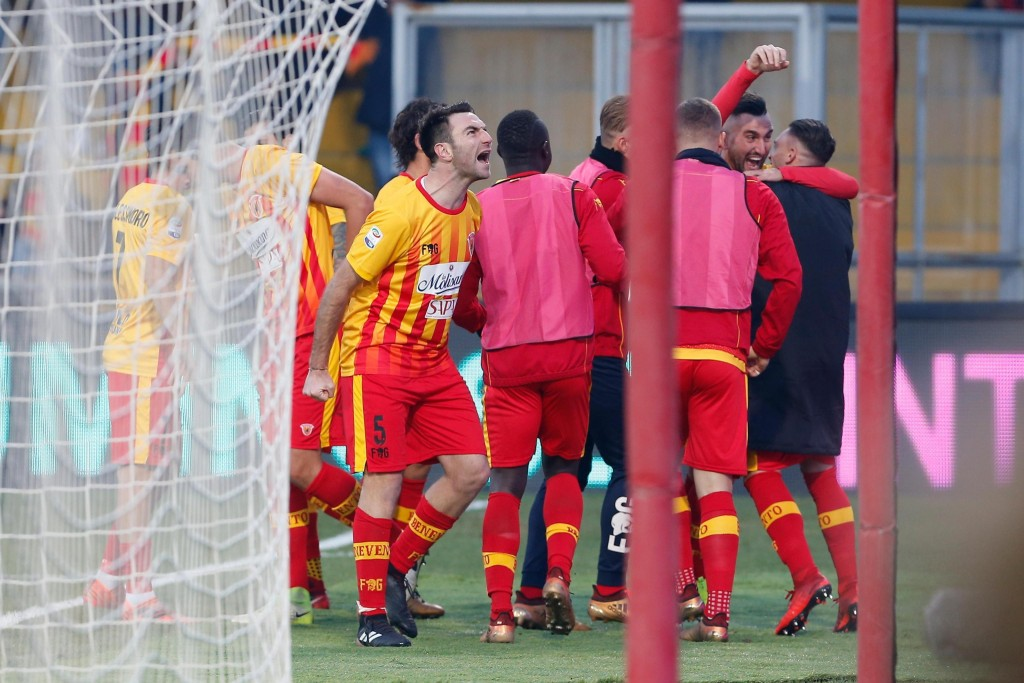 Benevento's Massimo Coda celebrates with his teammates after scoring during the Italian Serie A soccer match between Benevento and Chievo Verona at th...