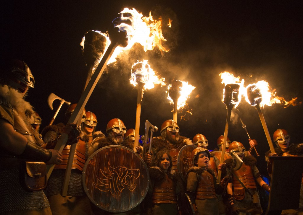 People dressed as Vikings get ready to lead a torchlight procession in Edinburgh, which marks the opening of Edinburgh's New Year celebrations, Saturd