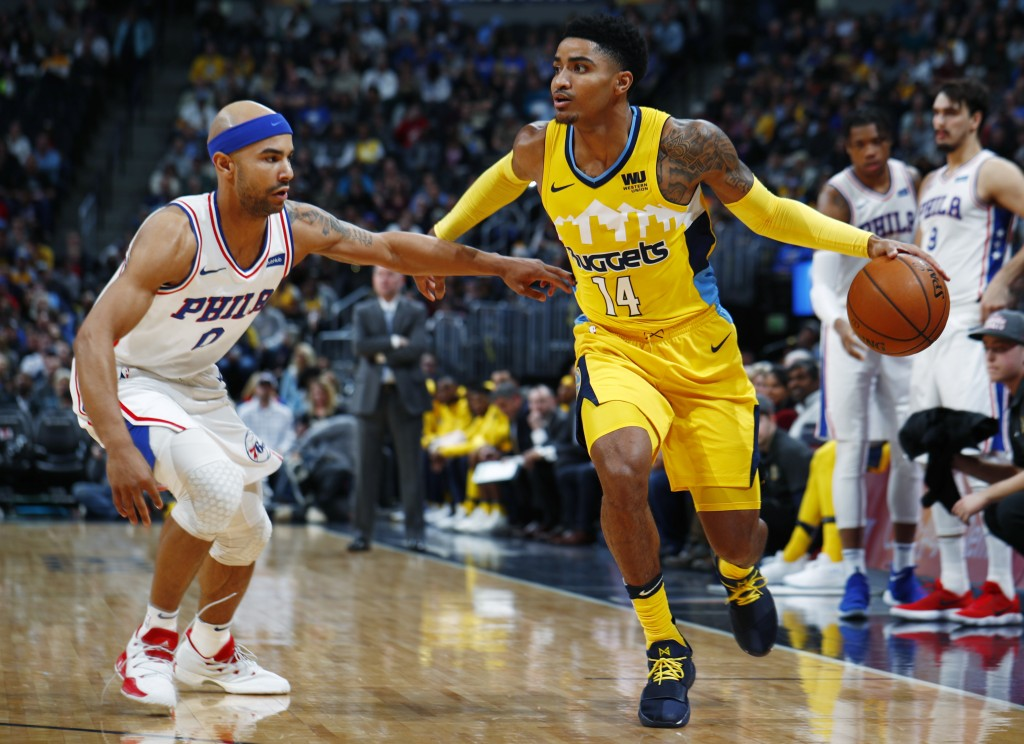 Denver Nuggets guard Gary Harris, right, drives past Philadelphia 76ers guard Jerryd Bayless in the first half of an NBA basketball game Saturday, Dec...