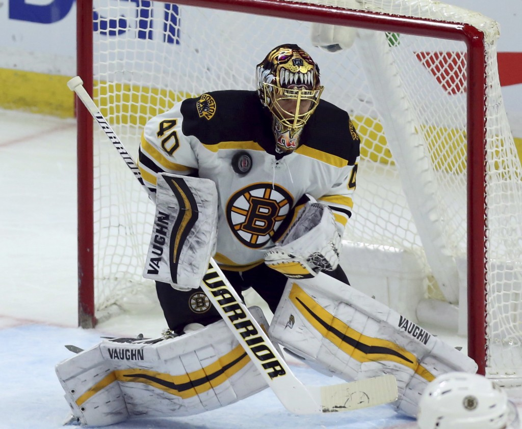 Boston Bruins goalie Tuukka Rusk makes a chest save against the Ottawa Senators during the second period of an NHL hockey game Saturday, Dec. 30, 2017...