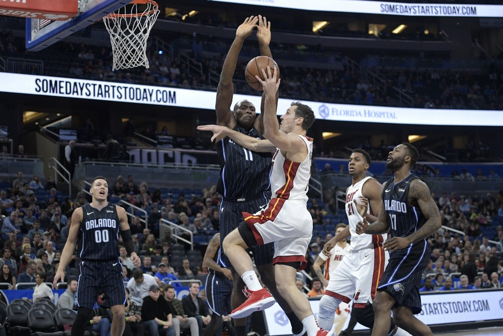Miami Heat guard Goran Dragic goes up to shoot in front of Orlando Magic center Bismack Biyombo (11) as forward Aaron Gordon (00) and forward Jonathon...