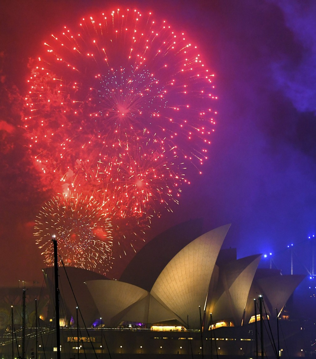 Fireworks explode over the Opera House during New Year's Eve celebrations in Sydney, Australia, Sunday, Dec. 31, 2017. (David Moir/AAP Image via AP)