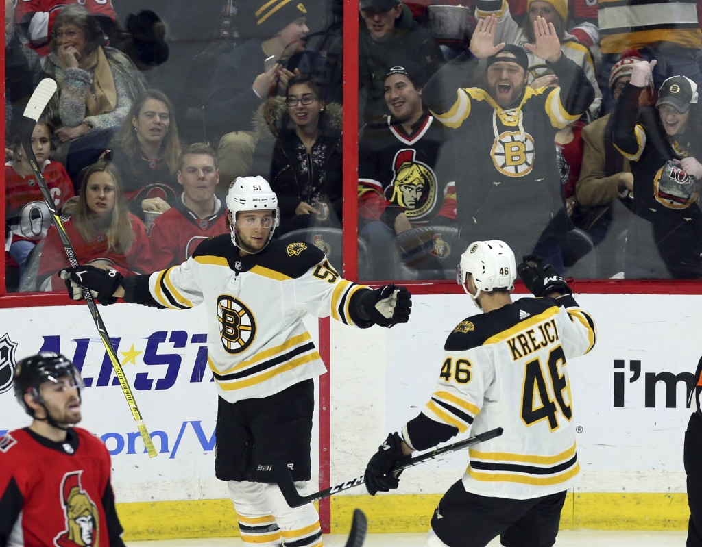 Boston Bruins' Ryan Spooner (51) celebrates his second goal of the night with teammate David Krejci (46), against the Ottawa Senators during the secon...