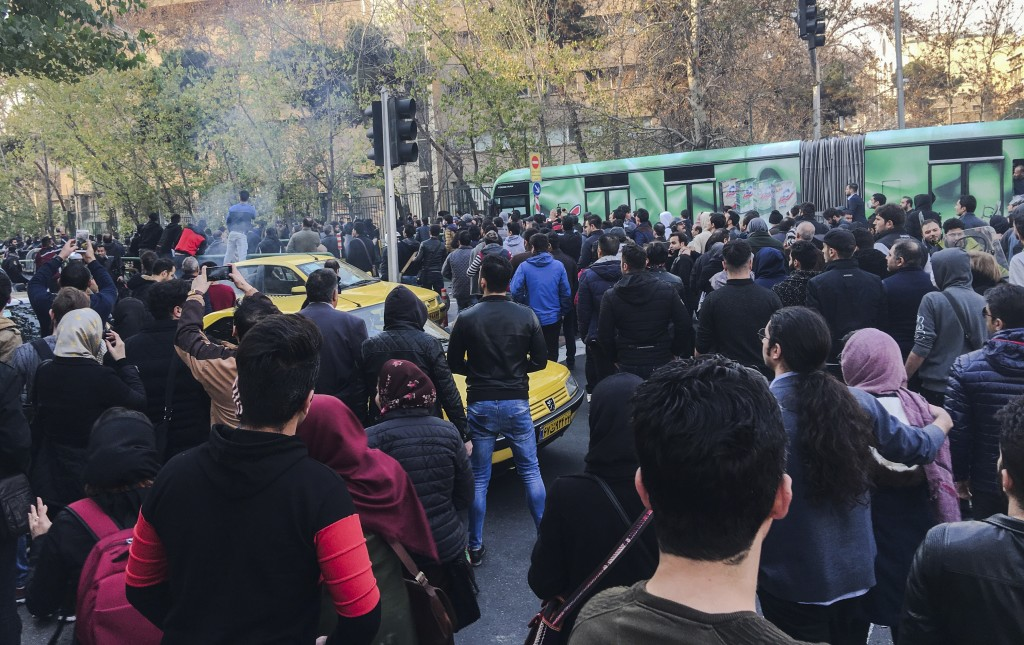 This photo taken by an individual not employed by the Associated Press and obtained by the AP outside Iran, demonstrators attend a protest over Iran's...