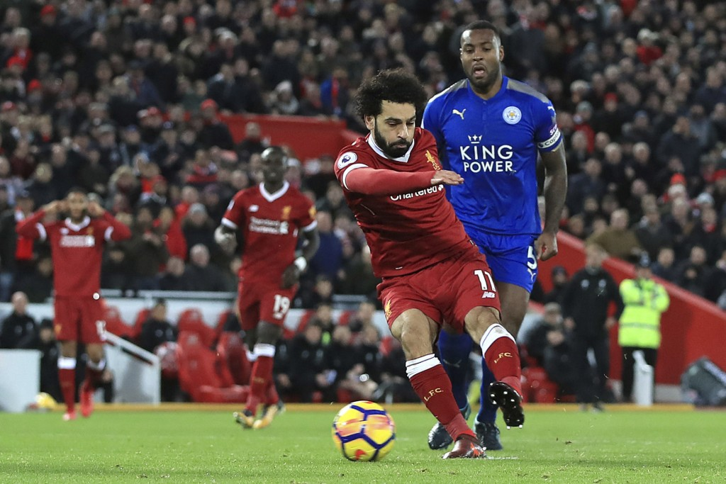 Liverpool's Mohamed Salah scores his side's first goal against Leicester City during the English Premier League soccer match at Anfield, Liverpool, En...