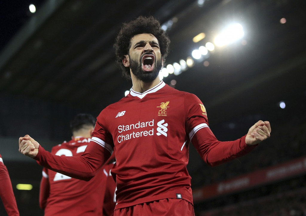 Liverpool's Mohamed Salah celebrates scoring his side's second goal against Leicester City during the English Premier League soccer match at Anfield, ...