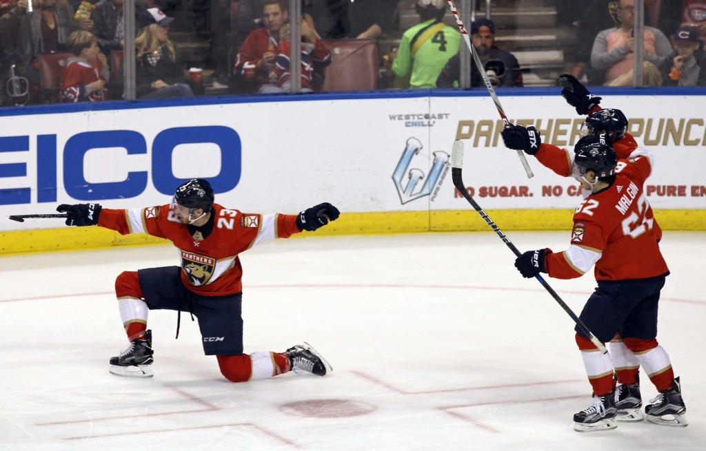 Florida Panthers' Connor Brickley (23) celebrates after scoring a goal against the Montreal Canadiens as teammates Denis Malgin (62), of Switzerland, ...