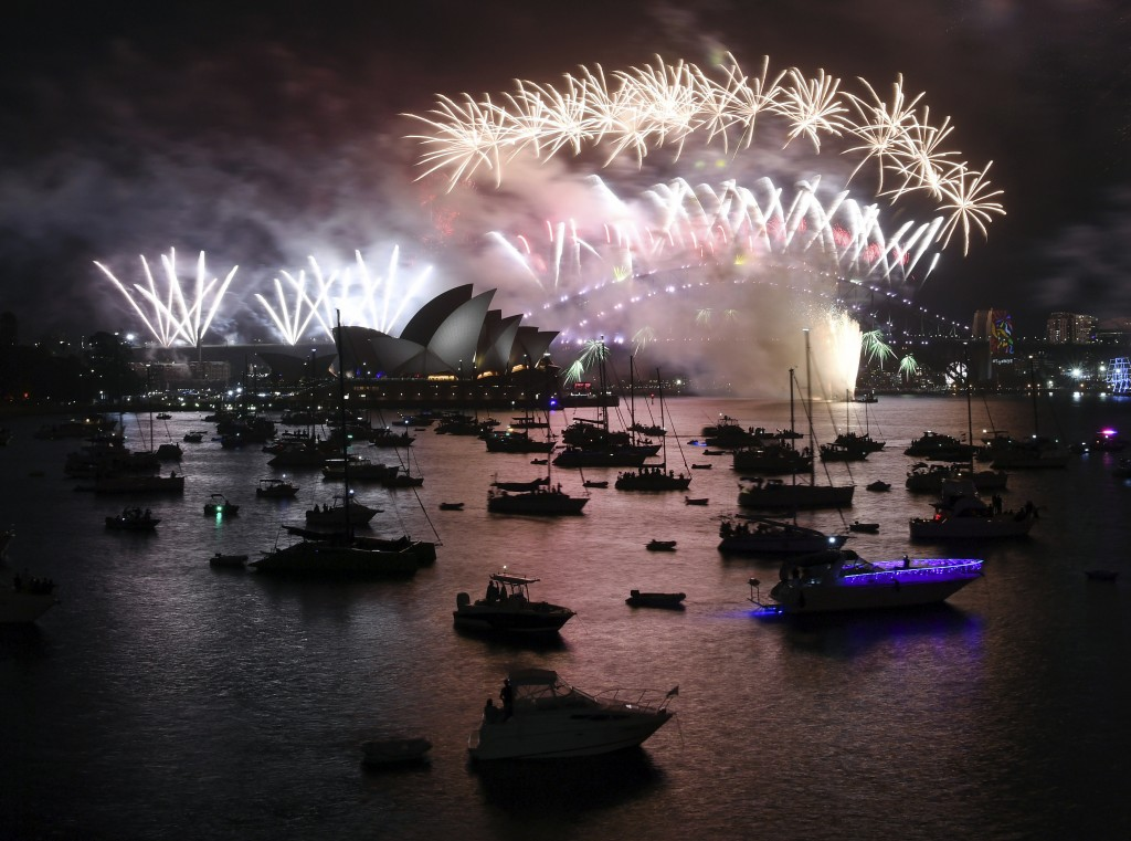 Fireworks explode over Sydney Harbour during New Year's Eve celebrations in Sydney, Monday, Jan. 1, 2018. (David Moir/AAP Image via AP)