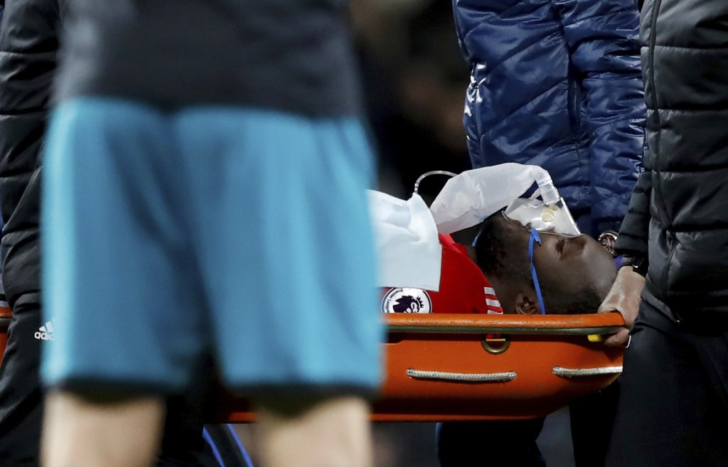 Manchester United's Romelu Lukaku is carried off on a stretcher after suffering a head injury  during the English Premier League soccer match Manchest...