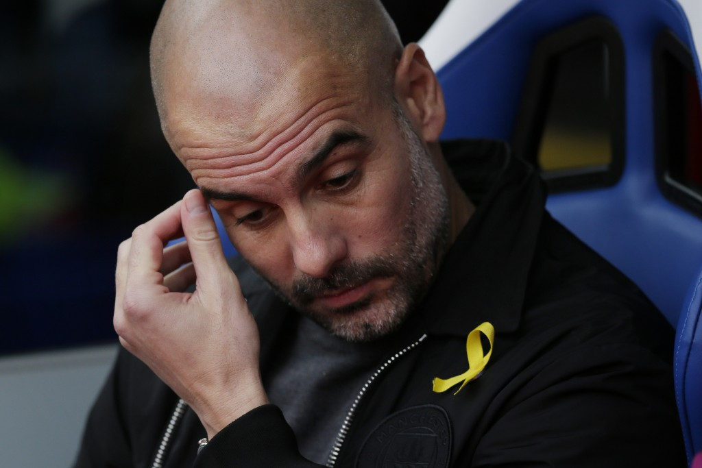 Manchester City manager Pep Guardiola looks down before the English Premier League soccer match between Crystal Palace and Manchester City at Selhurst...