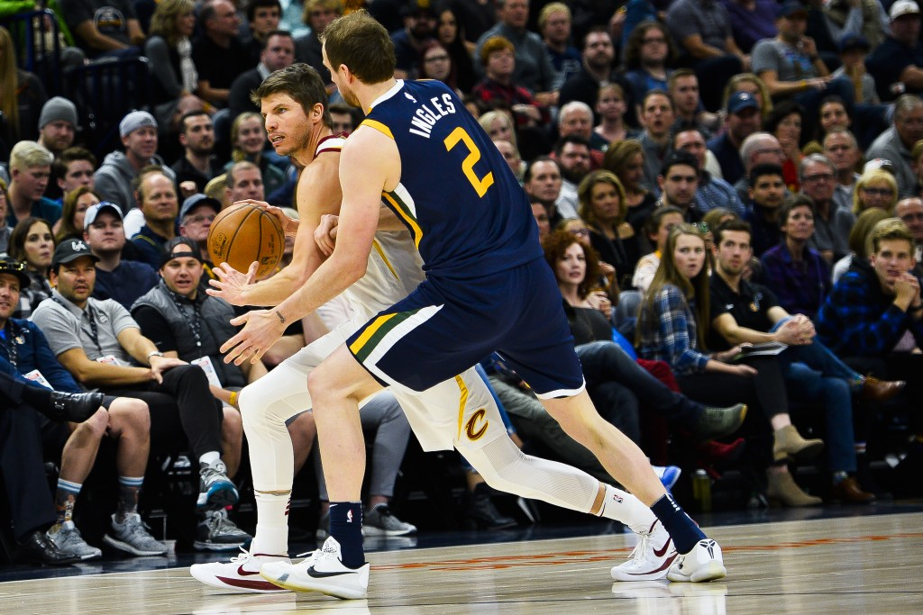 Cleveland Cavaliers guard Kyle Korver, left, attempts to dribble past Utah Jazz forward Joe Ingles, right, in the first half of an NBA basketball game...