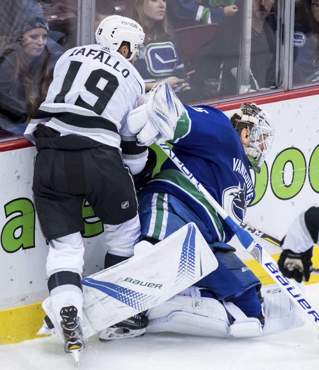 Los Angeles Kings' Alex Iafallo, left, skates up against Vancouver Canucks goalie Jacob Markstrom, of Sweden, during the second period of an NHL hocke...