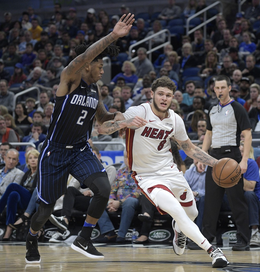Miami Heat guard Tyler Johnson (8) drives to the basket in front of Orlando Magic guard Elfrid Payton (2) during the second half of an NBA basketball ...