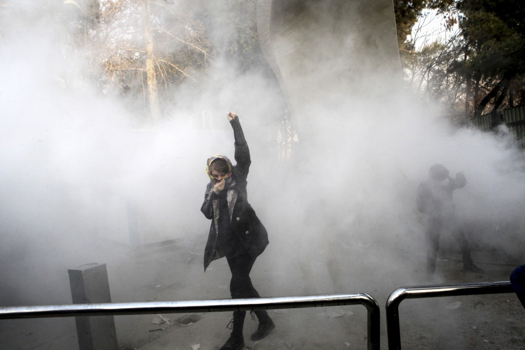 In this photo taken by an individual not employed by the Associated Press and obtained by the AP outside Iran, a university student attends a protest ...