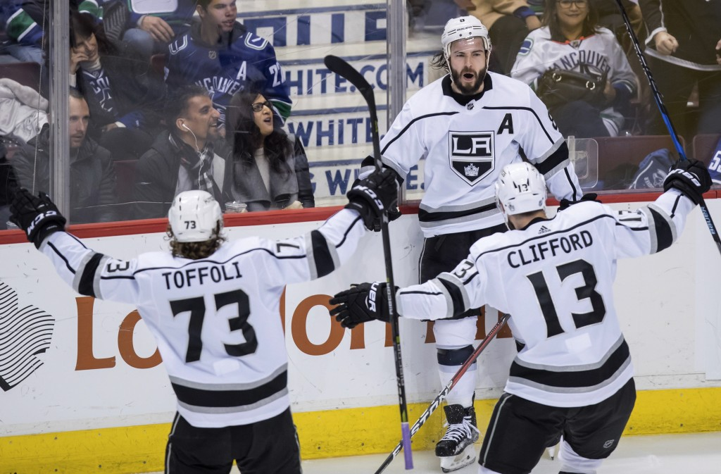 Los Angeles Kings' Drew Doughty, back right, celebrates his goal with Tyler Toffoli (73) and Kyle Clifford (13) against the Vancouver Canucks during t...