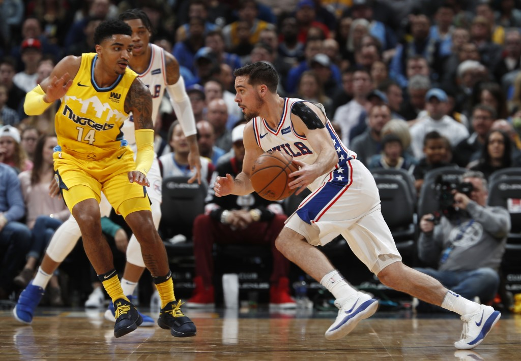 Philadelphia 76ers guard T.J. McConnell, right, drives toward Denver Nuggets guard Gary Harris in the first half of an NBA basketball game Saturday, D...