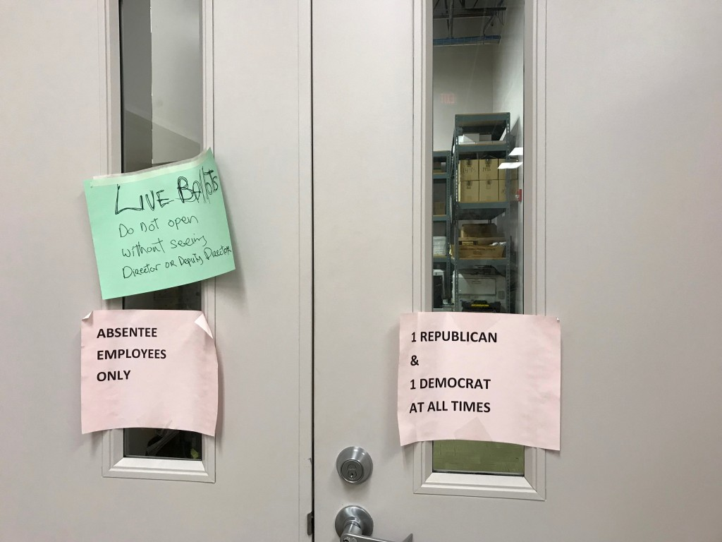 In this Dec. 14, 2017 photo, signs are posted on entry doors to a ballot storage area at the Franklin County Board of Elections in Columbus, Ohio. The...