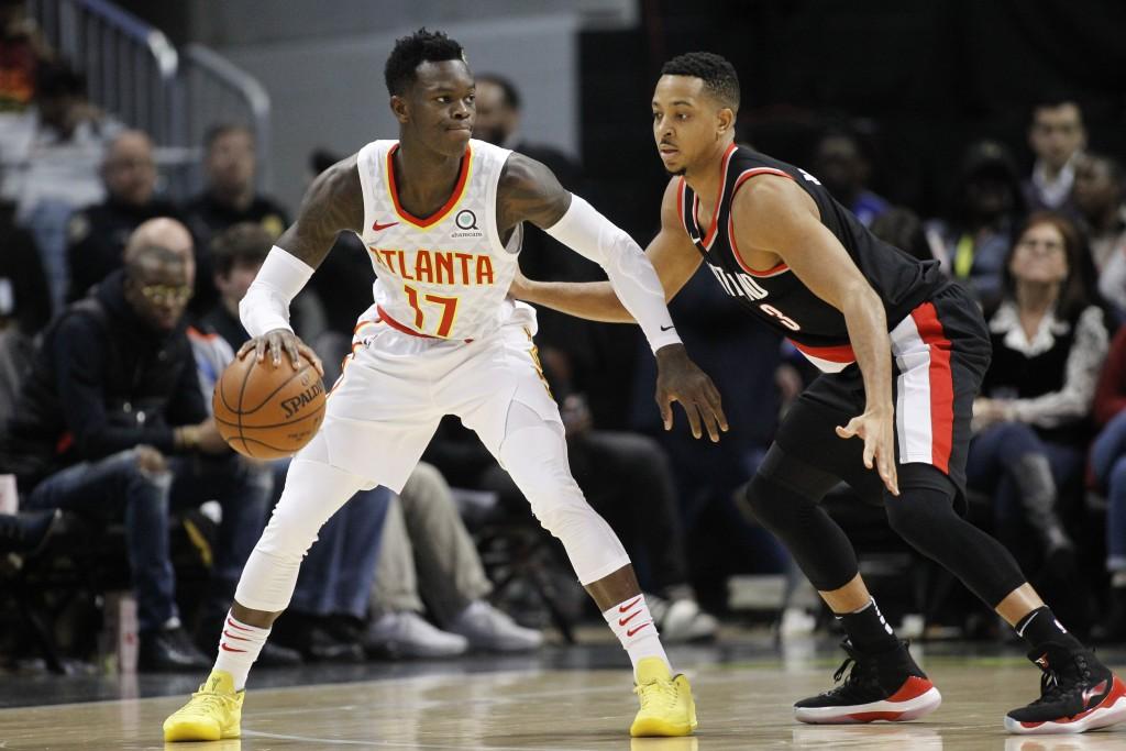 Atlanta Hawks guard Dennis Schroder (17) is defended by Portland Trail Blazers guard CJ McCollum (3) in the first half of an NBA basketball game, Satu...
