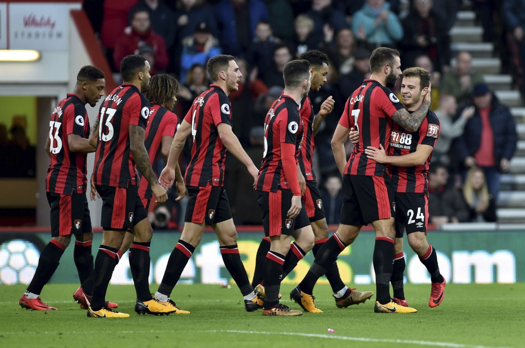 AFC Bournemouth's Ryan Fraser, right, celebrates scoring his side's first goal against Everton with his teammates during the English Premier League so...