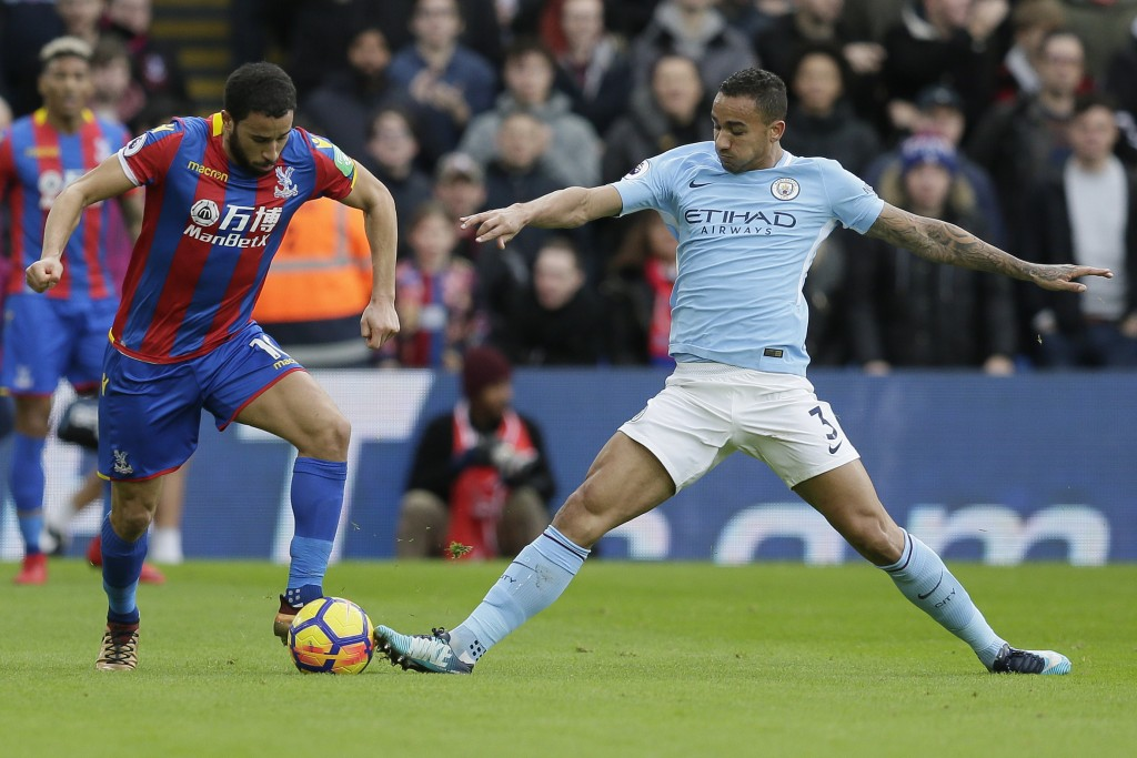 Crystal Palace's Andros Townsend, left, competes for the ball with Manchester City's Ilkay Gundogan during the English Premier League soccer match bet...