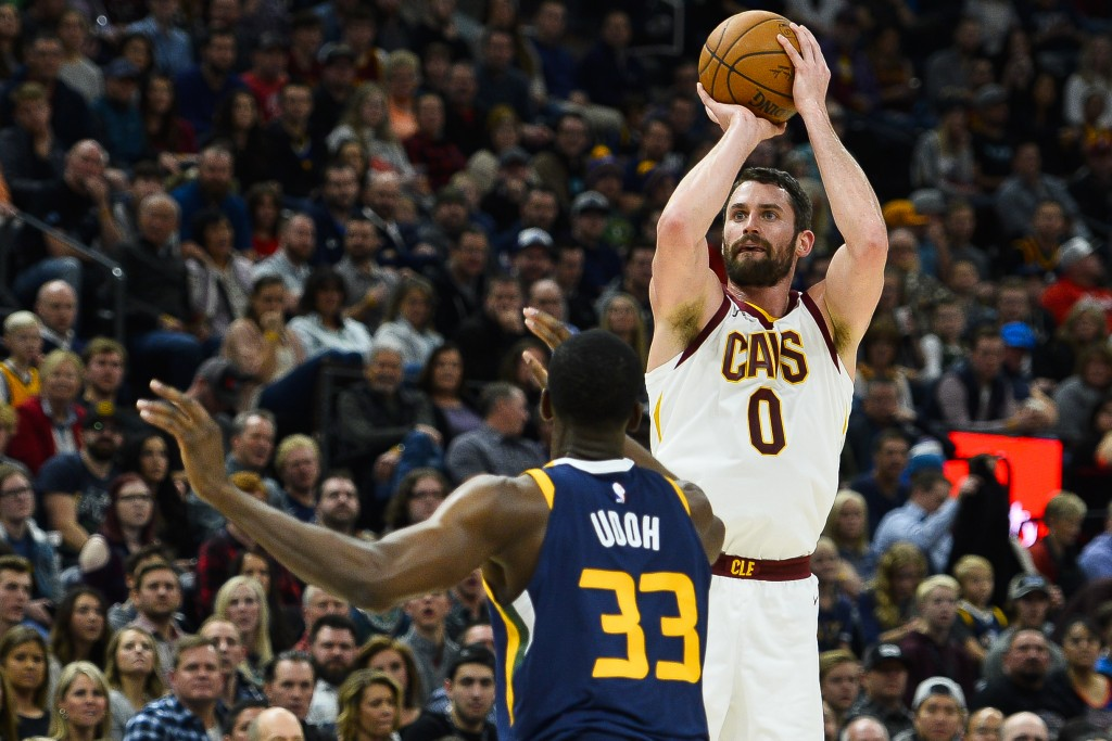 Cleveland Cavaliers forward Kevin Love (0) shoots over Utah Jazz center Ekpe Udoh (33) in the first half of an NBA basketball game Saturday, Dec. 30, ...