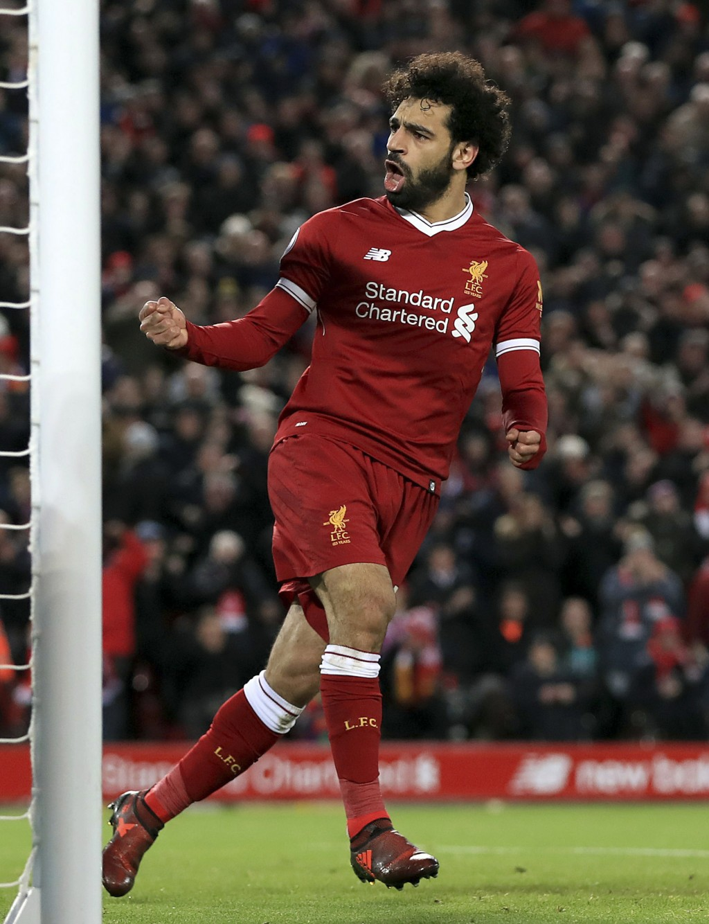 Liverpool's Mohamed Salah celebrates scoring his side's first goal against Leicester City during the English Premier League soccer match at Anfield, L...