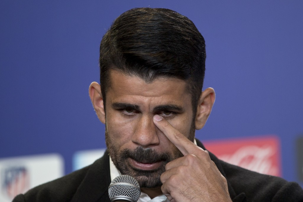 Diego Costa pauses while responding to journalists questions during his official presentation for Atletico Madrid at the Wanda Metropolitano stadium i...