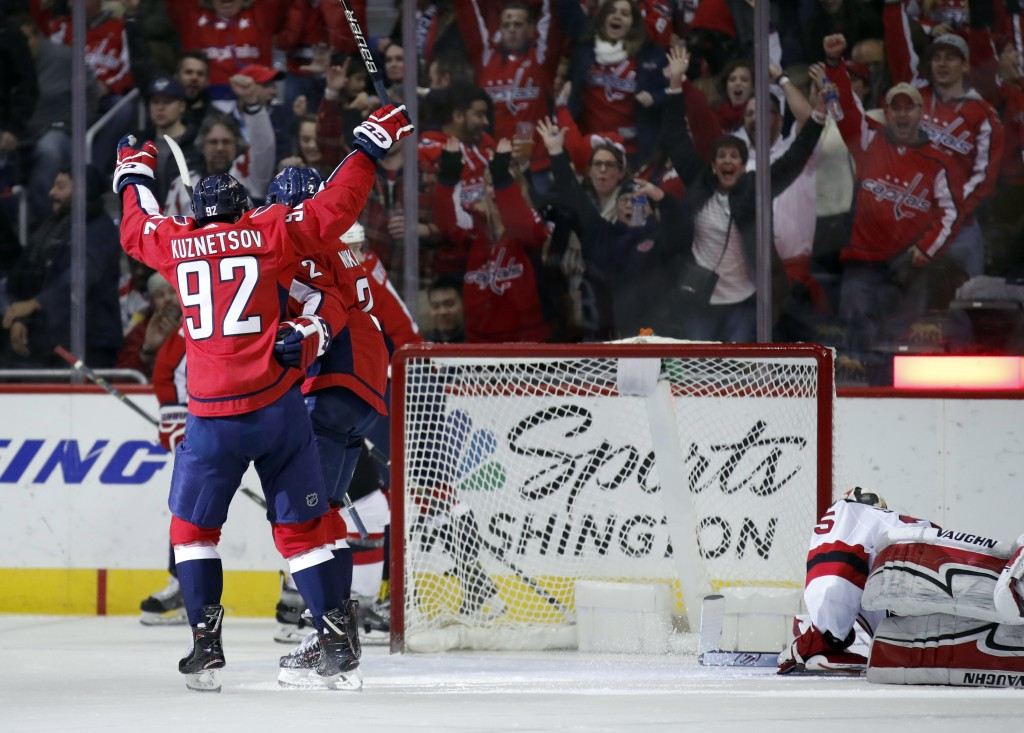 Washington Capitals center Evgeny Kuznetsov (92), from Russia, celebrates with defenseman Matt Niskanen (2) and others, after Niskanen's goal past New...