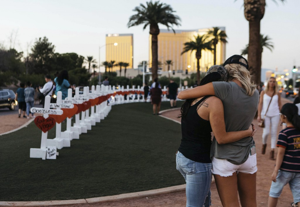 FILE - In this Oct. 5, 2017, file photo, a memorial displaying 58 crosses by Greg Zanis stands at the Welcome To Las Vegas Sign in Las Vegas. Each cro