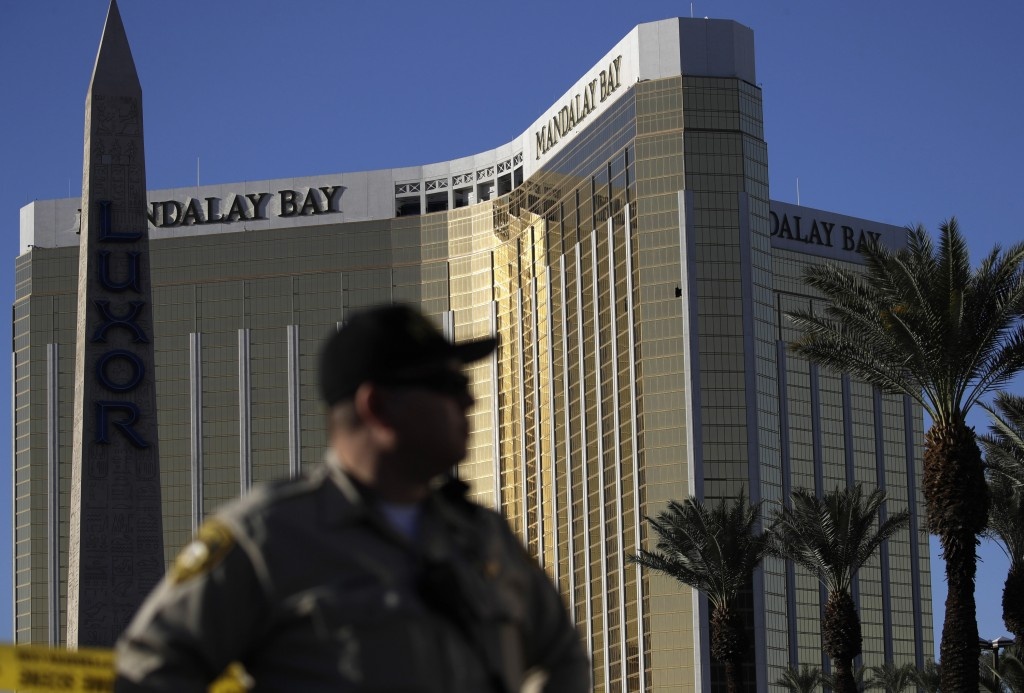 FILE - In this Oct. 3, 2017 file photo, a Las Vegas police officer stands by a blocked off area near the Mandalay Bay casino in Las Vegas. On Sunday,