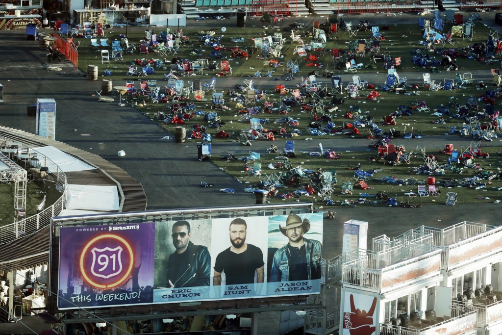 FILE - In this Oct. 3, 2017 file photo, personal belongings and debris litters the Route 91 Harvest festival grounds across the street from the Mandal