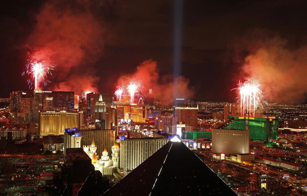 FILE - In this Jan. 1, 2015, file photo, fireworks explode above the Strip to ring in the new year in Las Vegas. Tens of thousands of revelers will ri