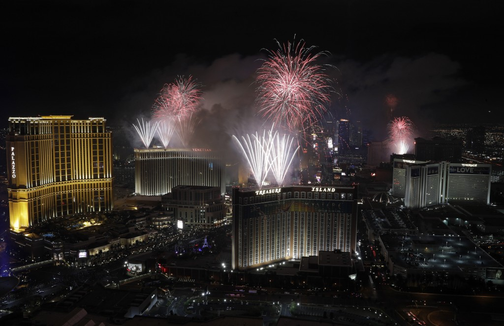 FILE - In this Jan. 1, 2017, file photo, fireworks explode over the Las Vegas Strip during a New Year's Eve celebration in Las Vegas. Tens of thousand